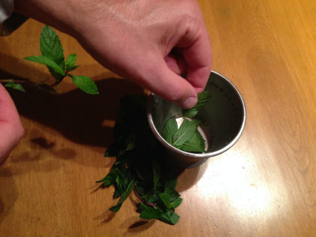 Adding the Mint to a Mint Julep